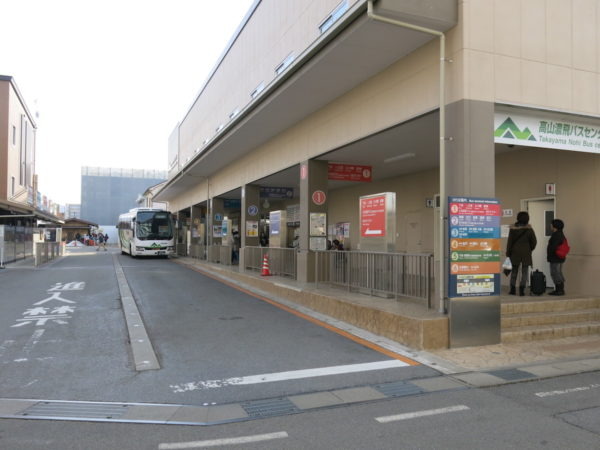 Bus stops are located in front of bus terminal.