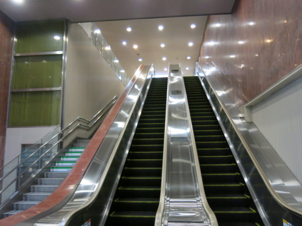 Escalator to Bus Center at third floor